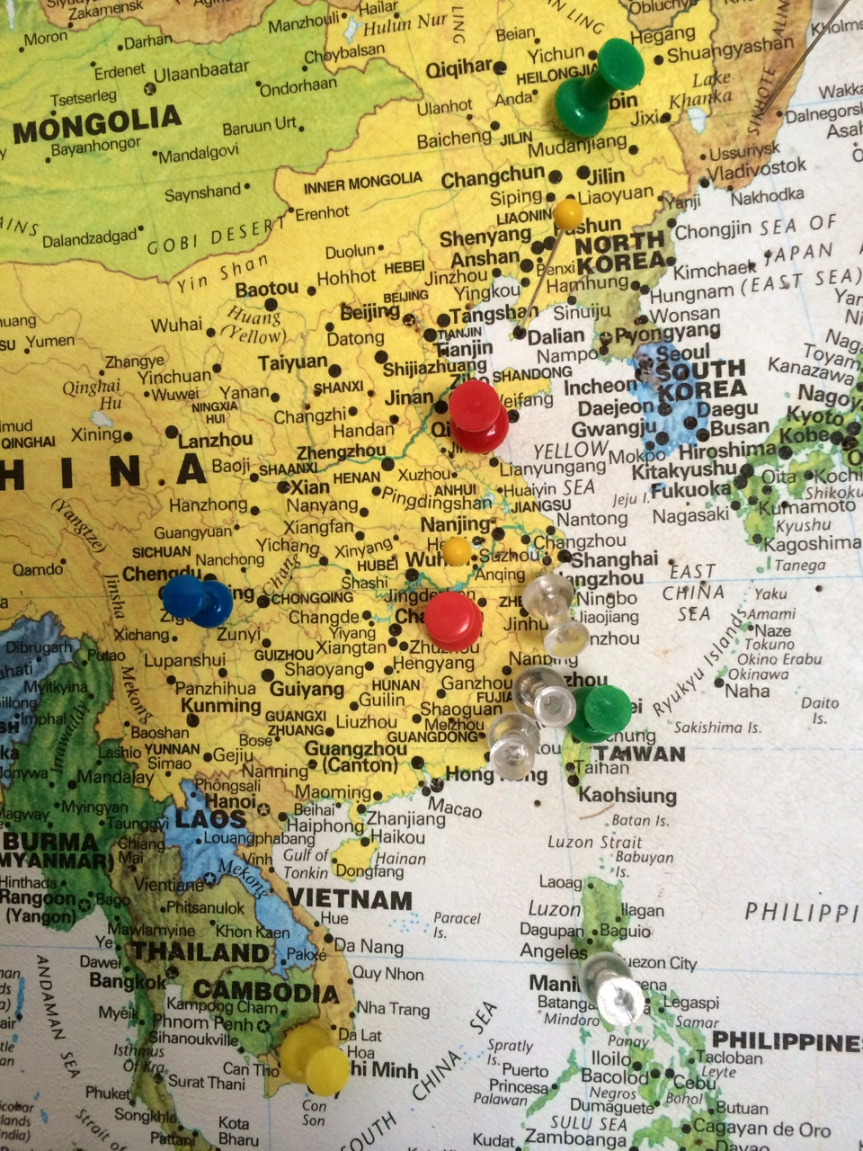 map with pushpins showing where visitors come from; detail of world map showing East Asia
