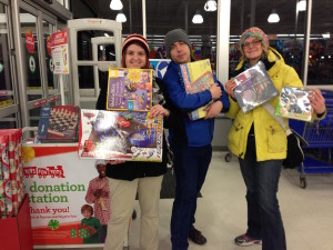 grad students pose near store doors with toys and games